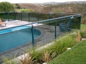 Powder coated stainless steel stanchions with tinted glass and top rail 1
